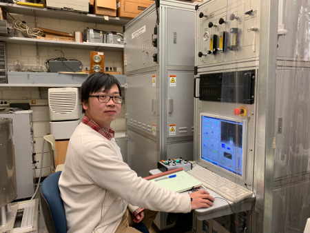 photo of Bin Gao working on a laser-heated floating zone furnace (Feb. 2019)
